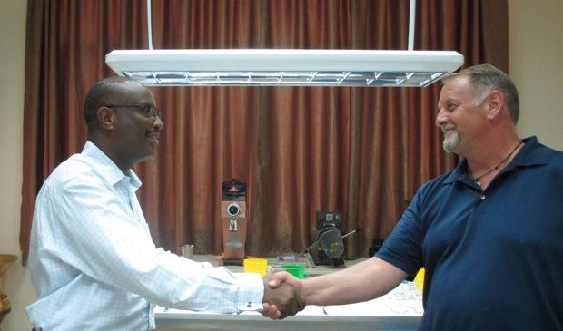 Skip Finley (right) of the SCAA Board Congratulates Aman Adinew, CEO of Metad.