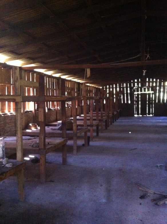 An example of farmworker housing in Central America, where men, women and children may live for three months.