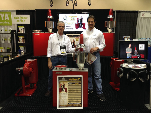 Coffee Crafters booth featuring the new Artisan V Fluid Bed Roaster (President Ken Lathrop on left)