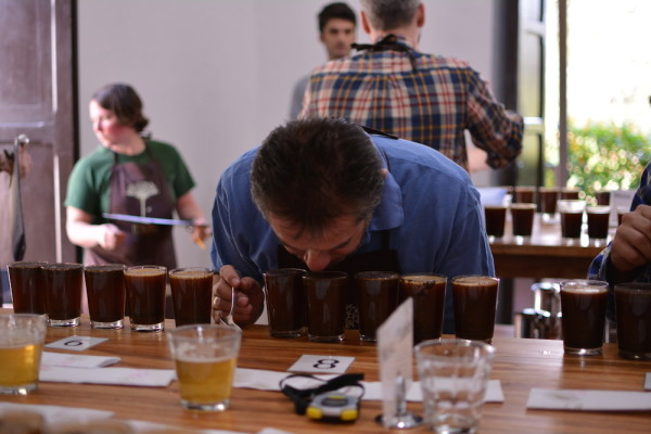Fernando Gómez Cruz, Q-Grader at Virmax, makes his way around the cupping table