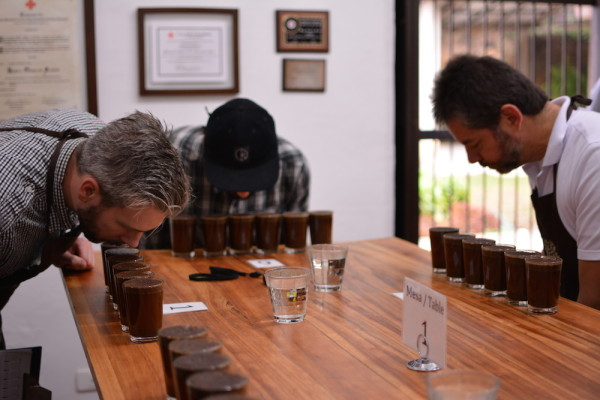 Geoff Woodley from Detour Coffee, Josh from Heart and Fernando Gómez Cruz make their way around the cupping table