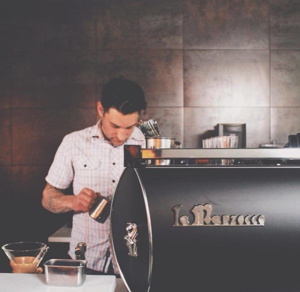 Damien behind the black matte custom La Marzocco GB/5