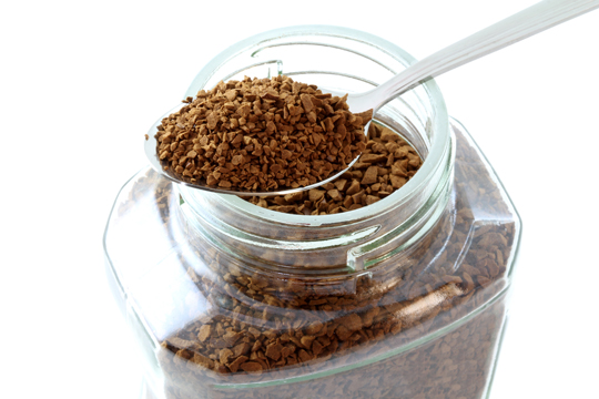 Instant coffee over fresh brewed coffee grounds
