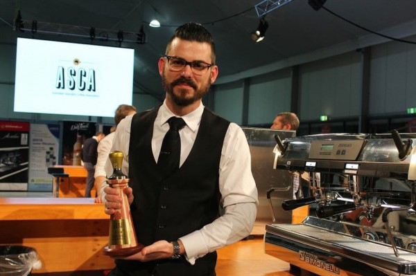 Craig Simon holding his second Australia Barista Champion trophy. DCN file photo courtesy of MICE.