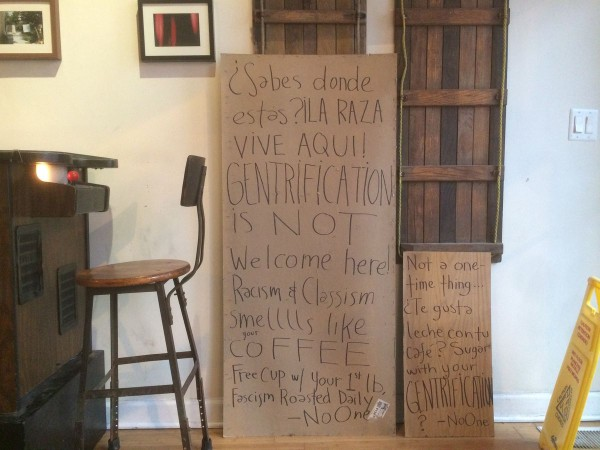 Bow Truss Coffee's Windows Covered with Anti-Gentrification Signs in Chicago