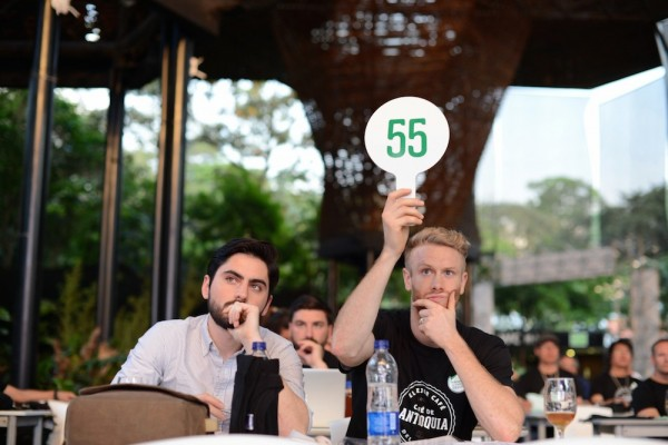 An auction concluded the Antioquia's Best Cup event.  Pictured are Ryan Wilcox and Jarrett Johnson, buyers from Lineage Coffee in Orlando. Photo by Mark Shimahara.