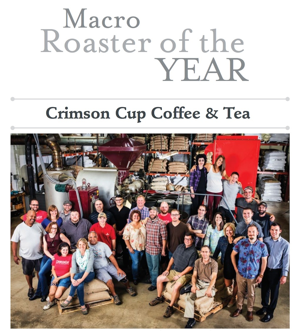 "The Crimson Cup team gathers around ""Godzilla,"" the company's 325-pound Roure roaster from Spain. Photo courtesy of EclipseCorp."