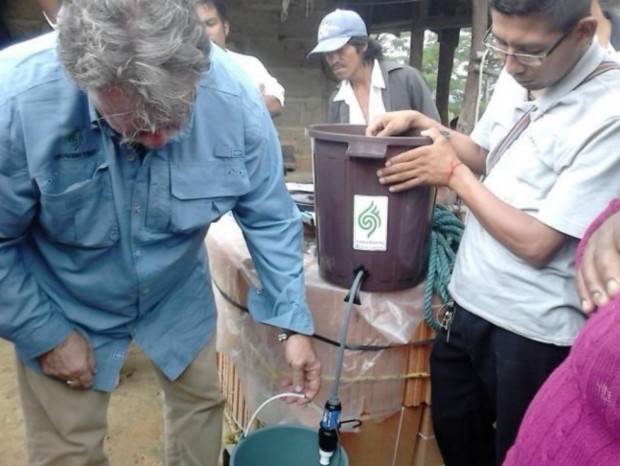 Dave Day (left) helping install water filtration systems supplied by Growers First to farmers in Oaxaca.