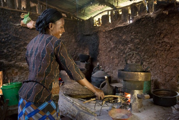 Mulane Jabessa using her cookstove. Jabessa is a coffee farmer in the Oromia region of Ethiopia, where the Oromia Coffee Farmers' Cooperative Union participated in a pilot program for the Fairtrade Carbon Credit program.