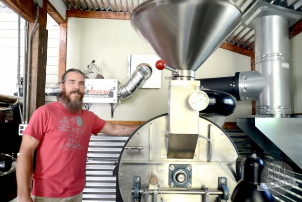 Adam Moore in the roasting garage. Photo by Angie Davis. Courtesy of Mill City Coffee Roasters.