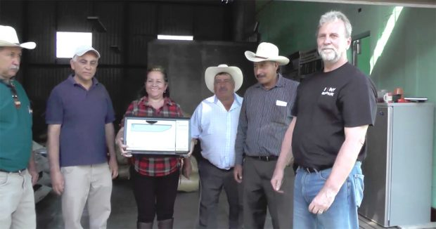 Jo Behm (right) with recipients at an Anacafé partner cooperative.