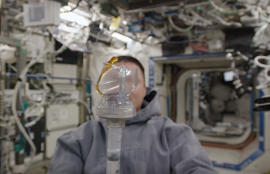 Astronaut Kjell Lindgren brewing coffee with a Space Cup at the ISS.
