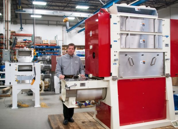MPE President Dave Ephraim standing with MPE's Vortex IMD 999 grinder. MPE photo.