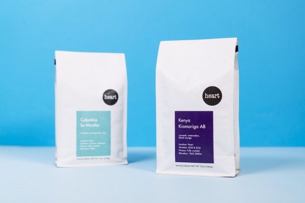 Heart Coffee Roasters bags, featuring a plain white bag with Futura type and color to represent each coffee. Needmore Designs photo.