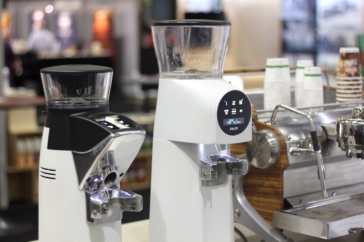 The Compak PKR-100 (right). Photo by Nick Brown/Daily Coffee News.