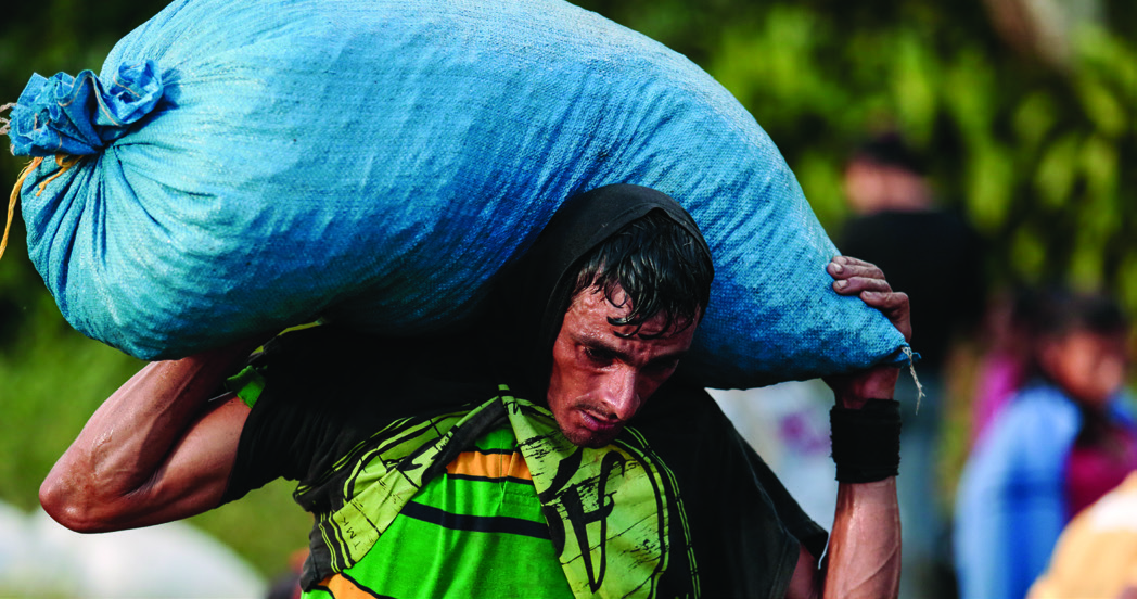 Armando Castro Chavarría, 30, lifts about 200 coffee bags per day, each weighing approximately 120 pounds. He believes he is paid about 25 percent more at La Revancha than he would earn at other coffee estates.