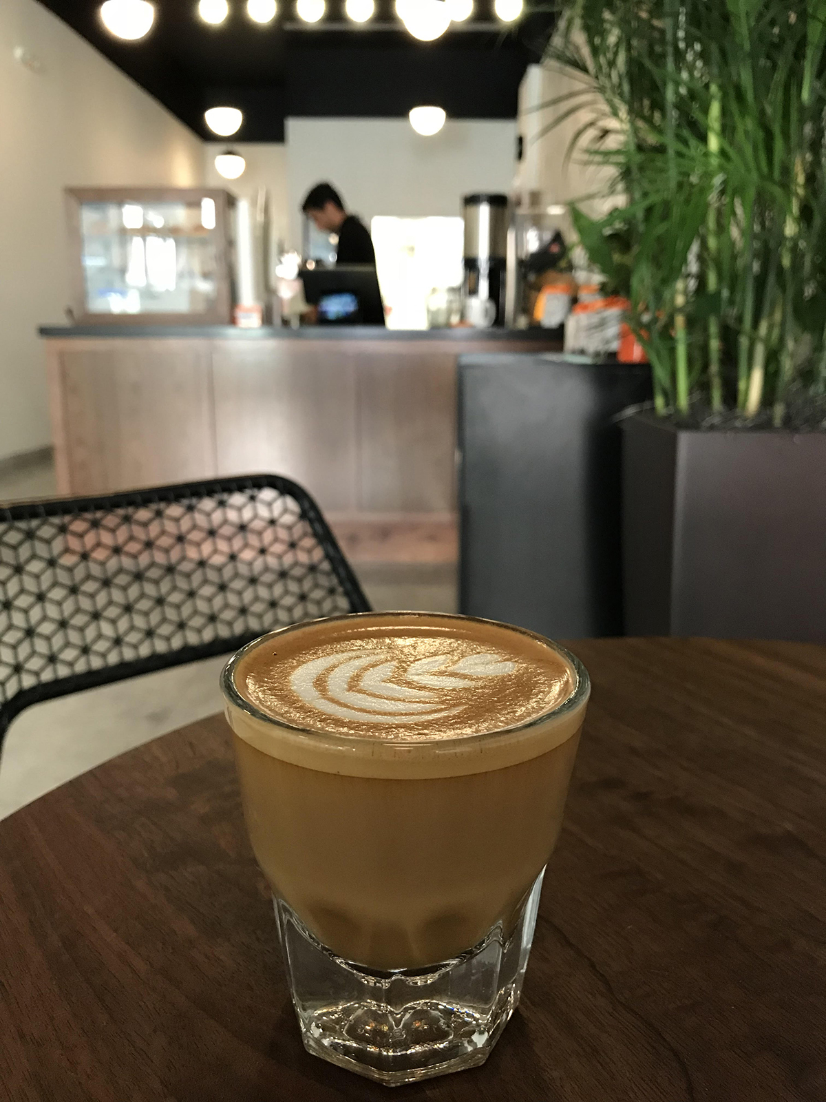 espresso drink with latte art at cafe grumpy in coral gables