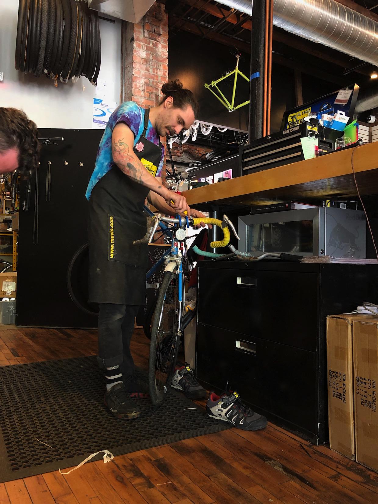 Benjamin Kehoe servicing a bike for a customer