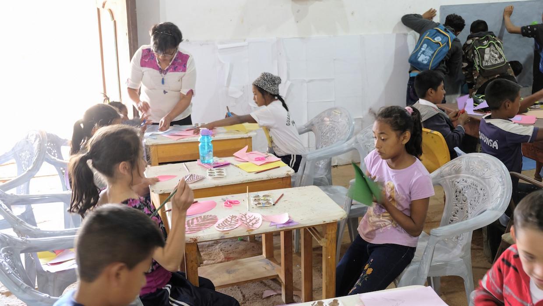 Children in Honduras doing art