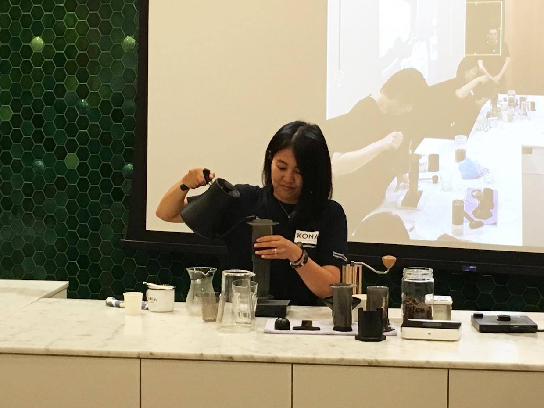 Towa Ikawa 1st place winner pouring water